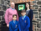 Kenny Campbell, Mrs Pollock (Charities Co-ordinator), Lucy and Sam pictured with the new defibrillator.